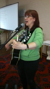 Debby Bloor leading worship on a Sunday morning